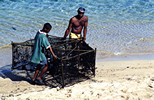 Father and son with fishtrap