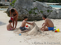 Family Building Sand Castles